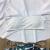 欧米のおじゃれはレディを着ています。上下に肩の大きなハスの叶の縁のハイイイエイの白いビキニの水が1861 mあります。